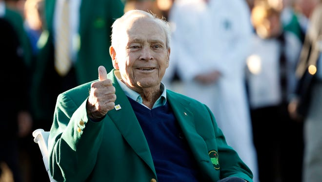 Honorary starter Arnold Palmer gives a thumbs up as he is seated along the first tee during the first round of the 2016 The Masters golf tournament at Augusta National Golf Club.