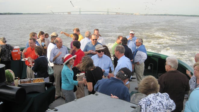 Guests enjoy the Tug Cruise hosted by World Trade Center Delaware in 2014.