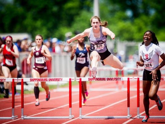 South Western's Lynne Mooradian clears the final hurdle in the Class AAA girls' 300-meter hurdles at the PIAA track and field championship meet at Shippensburg University Saturday. Mooradian placed second to earn the sixth state medal of her high school career.