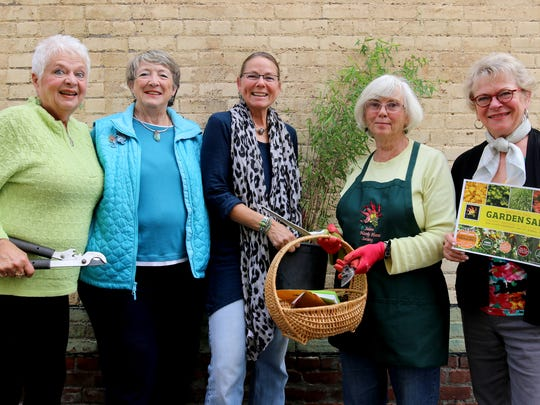 Salem Hardy Plant Society members, from left, Sherry Crowe, Rickie Hart, Doreen Wynja, Susan Hoskins, and Carolyn Kolb remind the public about the society's Annual Fall Garden Sale coming up this Saturday.