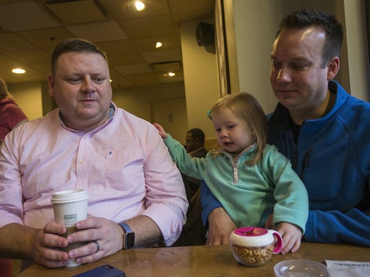 From left, Jayme Little, daughter Harper Little, 2, and husband Joel Wendland, of Irvington in Indianapolis, sit at a Starbucks before heading out to the Women's March on Washington in Washington, D.C., Saturday, Jan. 21, 2017.