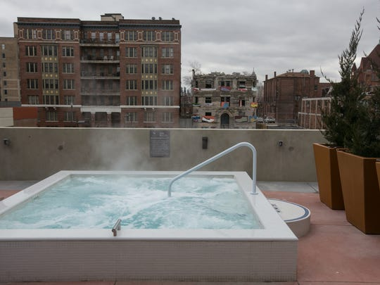 A year-round jacuzzi off of the second floor lounge area is seen at The Scott at Brush Park apartment complex near downtown Detroit on Wednesday February 8, 2017.