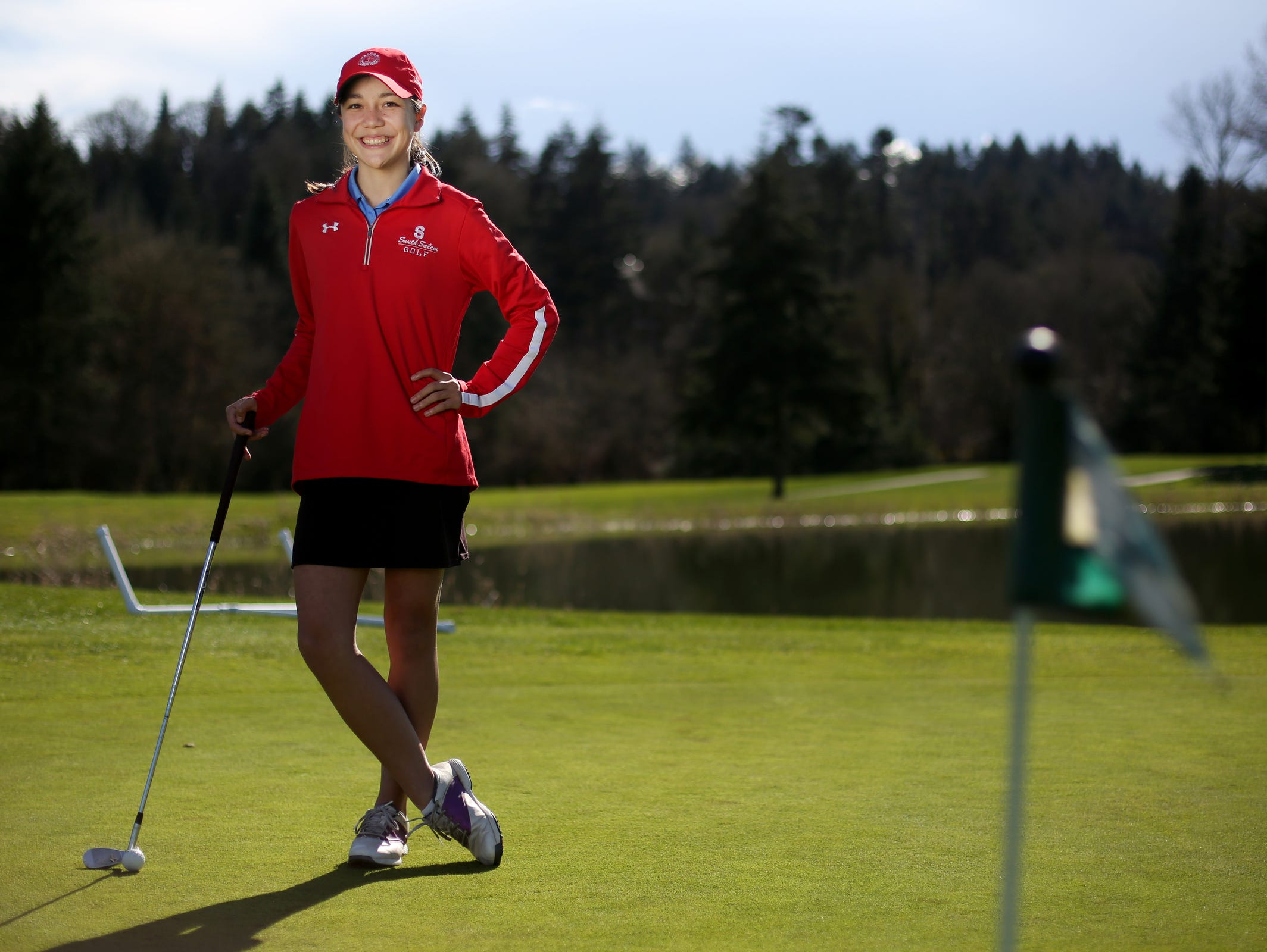 Ashley Zhu, a junior golfer at South Salem High School, stands for a photo at Creekside Golf Course in Salem on Tuesday, March 21, 2017.