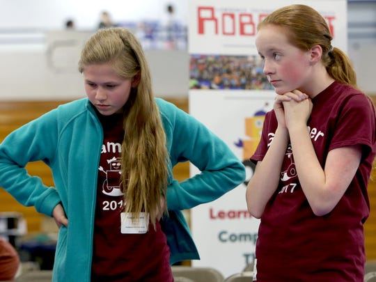Teammates Guppi Bryant, 14, left, and Meghan O'Kane, 13, wait nervously as their robot competes in the Robofest Michigan Championship on Saturday, May 13, 2017 at Lawrence Technological University in Southfield.