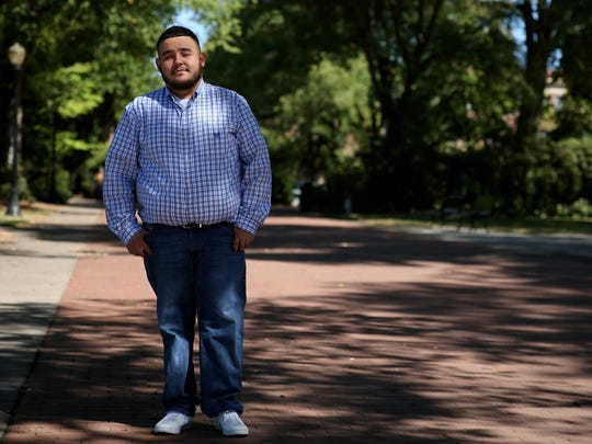 Juan Navarro, 24, was born in Mexico and grew up in Marion County, Oregon. Navarro earned a bachelor's degree from Western Oregon University and begins graduate school at Oregon State University in a couple of weeks. Navarro currently has Deferred Action for Childhood Arrivals (DACA) status. Photographed at Oregon State University in Corvallis on Thursday, Aug. 31, 2017.