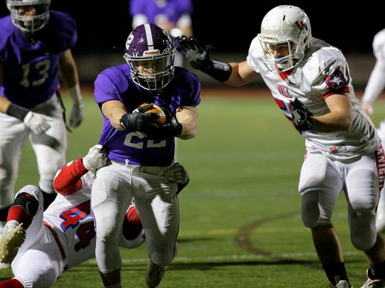 Rumson-Fair Haven's Peter Lucas scores a touchdown as Wall's Ryan Kellett and Ian Ackerman try to tacklle him during the 4th quarter of the Wall vs. Rumson-Fair Haven NJSIAA Central Group IV semifinal football game at Rumon-Fair Haven High School in Rumson, NJ Friday, November 17, 2017.