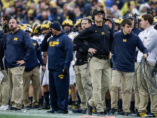 Michigan Wolverines coach Jim Harbaugh watches a play