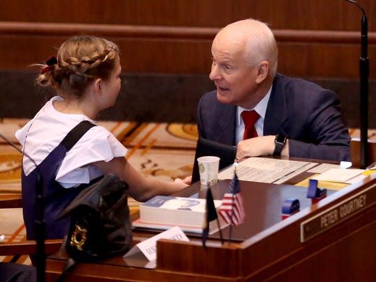 Secretary of State Dennis Richardson talks with Clara Lathen, who sang the National Anthem, before the start of the inauguration ceremony for Oregon's first Kid Governor, Dom Peters, a fifth grader at Willamette Valley Christian School, at the Oregon State Capitol in Salem on Monday, Jan. 8, 2018.