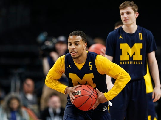 Michigan guard Jaaron Simmons practices at the Alamodome in San Antonio, Texas, Friday, March 30, 2018.