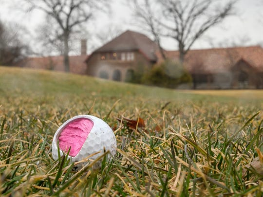 A broken golf ball is seen off of a green at Rackham Golf Course in Huntington Woods on Thursday, March 29, 2018.
