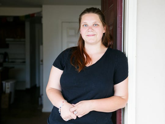 Karen Cole, 27, stands in the doorway of her small two-bedroom apartment on Friday, June 15, 2018. Cole has struggled to find a roommate to help with the cost of rent, and the unit does not have a dishwasher, washer, dryer or bathtub.