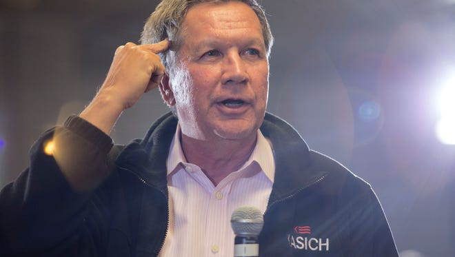 Presidential candidate Gov. John Kasich from Ohio speaks to supporters during a town hall meeting in Utica.