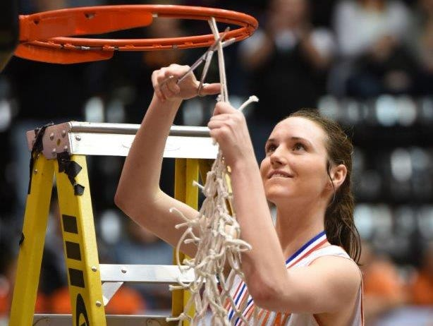 Silverton senior Alia Parsons cuts down the net after the Foxes won the OSAA Class 5A state championship.