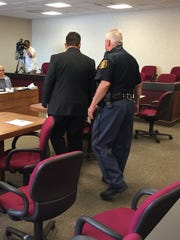 Michael Vultaggio is led from the courtroom after sentencing