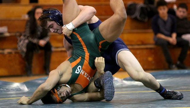 Suffern's Stephen Lauro, top, defeated East Ramapo's Jhavon Innocent 7-2 in the 170 pound bout during a wrestling meet at Ramapo High School, Jan. 13, 2016 in Spring Valley.