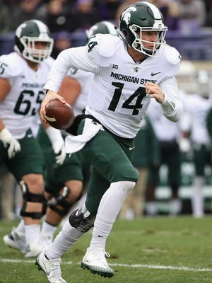 MSU QB Brian Lewerke runs for a first down against the Northwestern Wildcats at Ryan Field on October 28, 2017 in Evanston, Illinois.