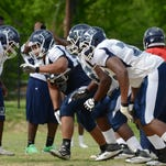 Alem Amores, center, is one of many new faces aiming for playing time on JSU's offensive line.