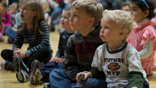 These youngsters seem enthralled with the performances during the Literacy Celebration at the Hannah Center in East Lansing Sunday, March 15, 2015.