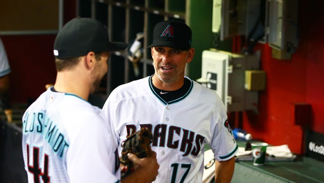 Apr 25, 2017: Arizona Diamondbacks manager Torey Lovullo (right) talks with first baseman Paul Goldschmidt prior to the game against the San Diego Padres at Chase Field.