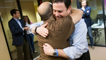 Gov. Doug Ducey hugs Steven Ramirez at the Yes on 123 Campaign Headquarters in Scottsdale May 17, 2016. Ramirez is an intern with Prop. 123.