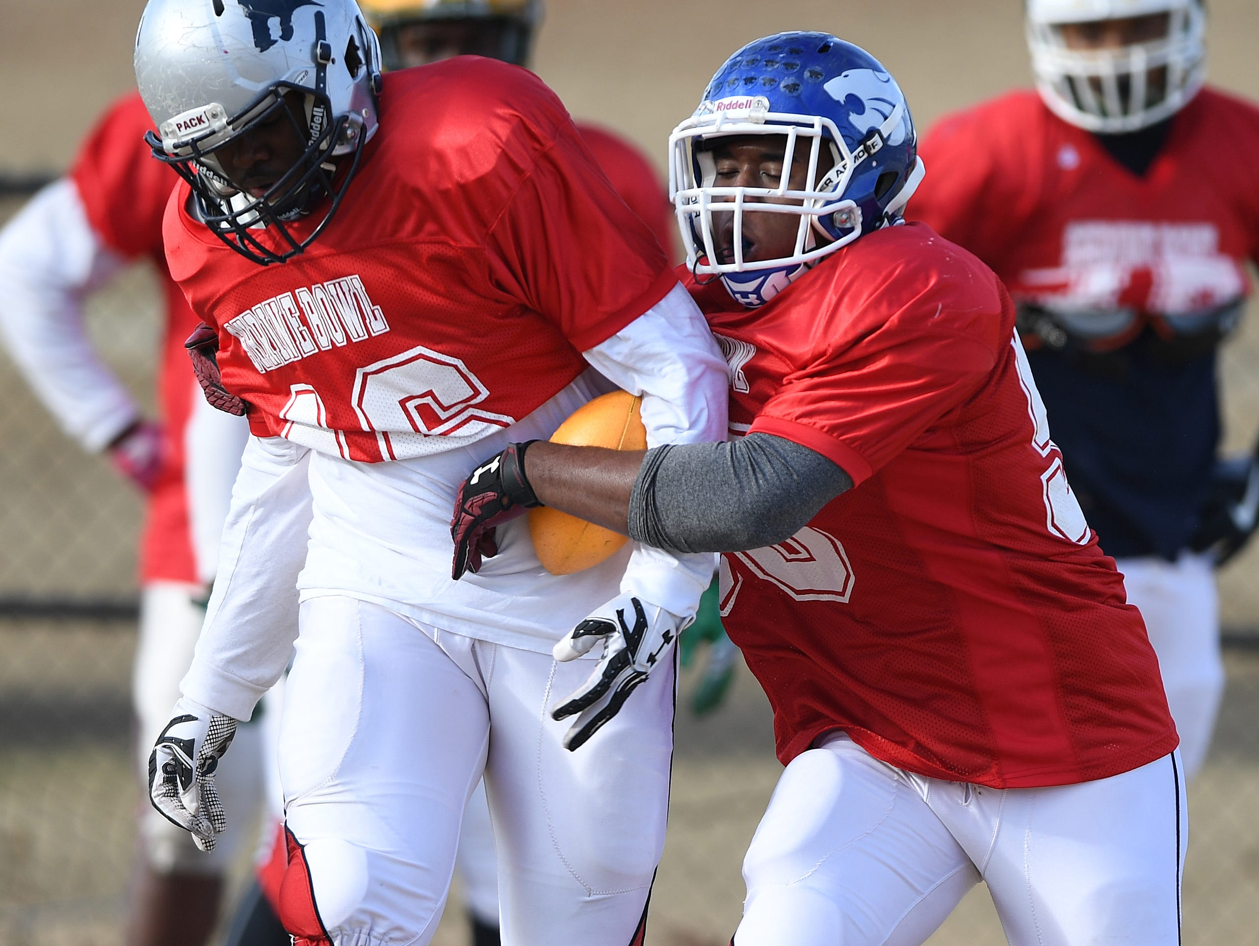 Woodmont's Davonne Bowen (90) strips the ball from Dillion's Jermaine McDaniel (46) during a drill at Shrine Bowl practice at Dorman High on Monday, Dec. 12, 2016.