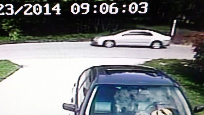 This silver or gray vehicle was spotted in the driveway of a home on Quinn Street on June 23rd and was driven by a black male with a clean shaven face.