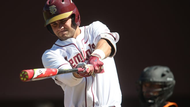 FSU's Nick Derr warms up before batting against Pacific during the Seminoles 18-5 win in the first game of their double-header on Saturday, May 6, 2017.