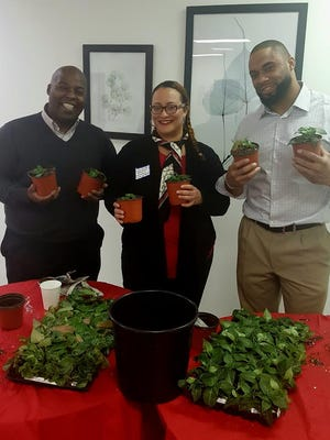 Anew Wellness, Jerome Mitchell, CEO, Candice Deglon, Managing Director, and Vernon Gholston, Executive Vice President, connecting with plants in a Horticultural Therapy activity facilitated by Laura DePrado of Final Touch Plantscaping, LLC., in preparation for March 10th in-house workshop.