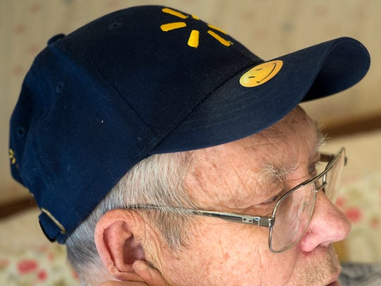 Henry Sutherland still wears his Walmart hat, with a smiley sticker on the bill. Sutherland, 80, who worked for WalMart for 10 years, was let go because, he believes, he hugged a child at the store.