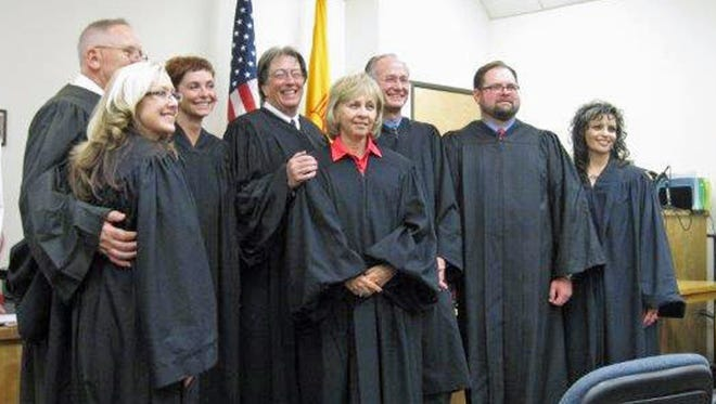 Pictured from left to right: Lincoln County Magistrate Judge Katie Lund, 12th Judicial District Judge Dan Bryant, 12th Judicial District Judge Angie K. Schneider, Chief 12th District Judge James W. Counts, Otero Magistrate Judge Irene Mirabal-Counts,12th Judicial District Judge Jerry H. Ritter Jr., Otero Magistrate Judge Scott Newton and Lincoln County Magistrate Judge Mickie Vega.