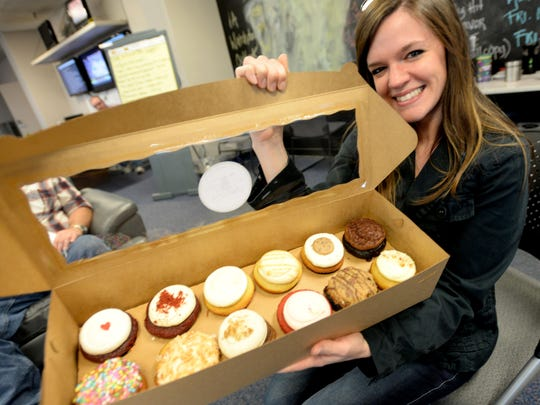 Courtney Spradlin with cupcakes at goodbye party.