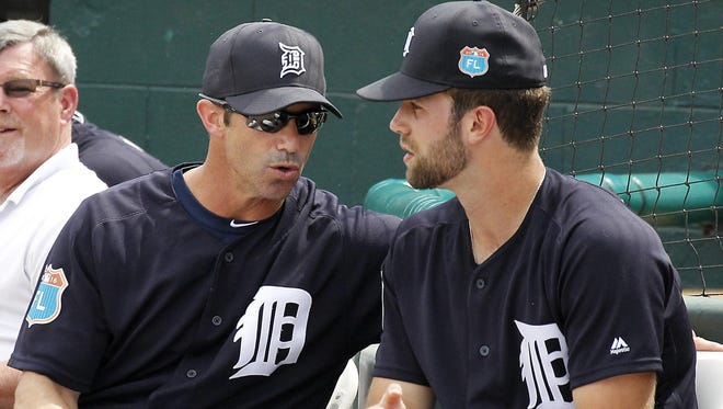 Tigers manager Brad Ausmus, left, told left-hander Daniel Norris to start inducing contact if he wants to pitch deeper in games.