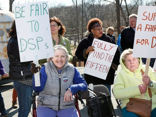 Direct Support Professionals and consumers attend a rally to support funding for a minimum wage increase to Direct Support Professionals at the Camp Venture Program Center in Stony Point on Friday, March 18, 2016.