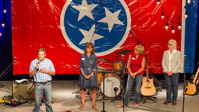 Businessman Bill Lee, left, speaks a Republican candidate for Tennessee governor, speaks at a fundraiser in Franklin, Tenn., on Sunday, Aug. 6, 2017. To his right are fellow candidates House Speaker Beth Harwell, U.S. Rep. Diane Black and state Sen. Mae Beavers. With the field largely set, some of the candidates have begun taking aim at each other in public appearances.