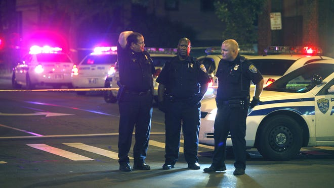 Officers gather on Hudson Avenue in Rochester Wednesday night.