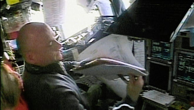 In this Friday, Aug. 10, 2007 image made from video provided by NASA, commander Scott Kelly sits in the flight deck of shuttle Endeavour as he prepares to dock with the International Space Station. On Friday, March 11, 2016, NASA announced Kelly's retirement, which begins April 1. The 52-year-old Kelly holds the American record for most time in space: 520 days.