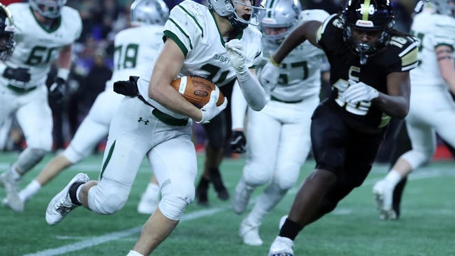 Duxbury's Tim Landolfi goes for a big gain during fourth-quarter action of the Division 3 state championship game at Gillette Stadium on Saturday, Dec. 7, 2019.