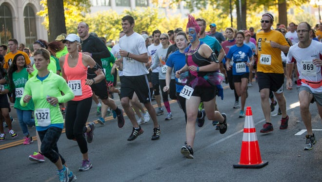 Runners compete in the Photo Finish 5K Saturday in Rochester.