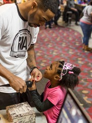 Firefly Music Festival act Amillion the Poet with his daughter Aaliyah in 2014.