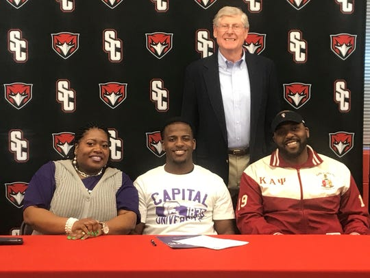 Stewarts Creek football standout D.J. Harris recently signed to play at Capital University in Columbus, Ohio. Pictured in the front row are D.J. Harris, middle, his mother, Cynthia Harris, and his father, Doug Harris. In the back row is SCHS football coach David Martin.
