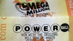 Powerball and Mega Millions lottery tickets are displayed