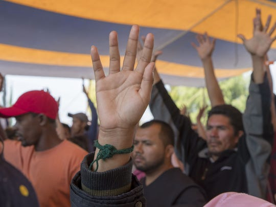 Central American migrants gathered outside a church in Puebla, Mexico, on April 7, 2018, for a caravan that hoped to travel to the U.S. border drawing the ire of President Trump.