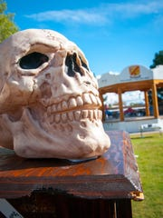 A skull forms part of a shrine to the Jimenez and Sandoval families on Mesilla Plaza.