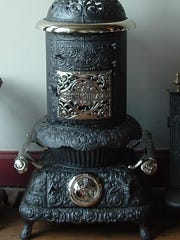 This Peninsular Stove Co. heating stove, designed to warm parlors, is almost figural in shape and accented with nickel plating.   Manufacturers offered hundreds of models in their catalogs.