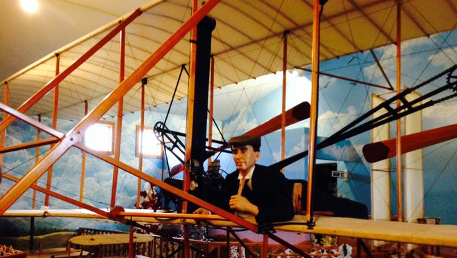 A full-size replica of Orville Wright and the airplane he flew at Kitty Hawk is one of the displays at the Wilbur Wright Birthplace and Museum in Henry County.