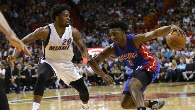 Detroit Pistons' Stanley Johnson (3) drives to the basket as Miami Heat's Justise Winslow (20) defends during the first half of an NBA basketball game, Tuesday, Dec. 22, 2015, in Miami.