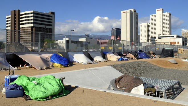 In 2008: A tent city has grown along the train trench just east of the men's shelter on Record Street.
