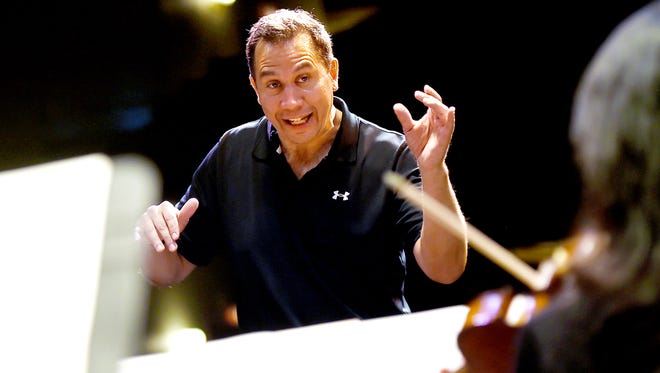 Daniel Hege, the new music director and conductor of the Binghamton Philharmonic, leads musicians during rehearsal at The Forum on May 3.