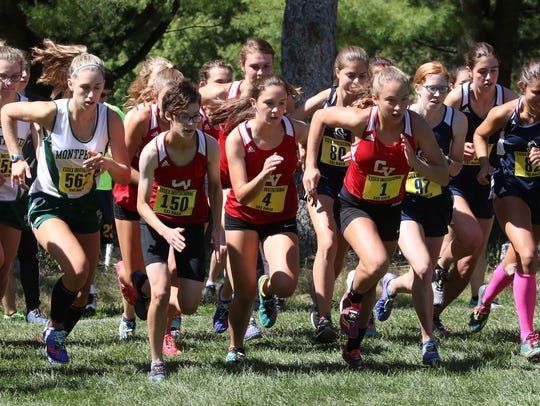 High school girls runner take off at the start of Saturday's