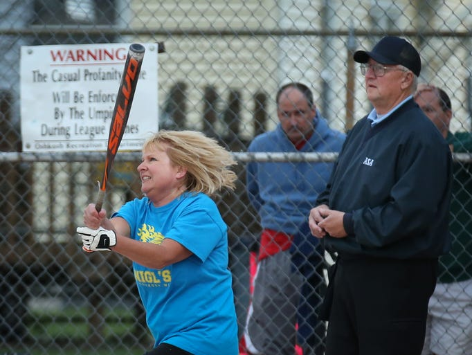 Kay Boss of Nigl's gets a hit. Women's softball action at Spanbauer Memorial Field Monday night, July 14, 2014.